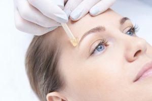 hot wax applied to eyebrow