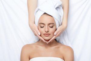 woman receiving facial treatment